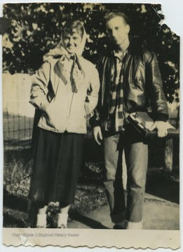 DeWitt, left, and Cooper, right, pose outside of Terra Alta High School during their senior year.