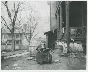 Side of the Flanagan home looking towards Summers Street.  Small child sits near a side porch.