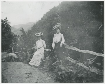 Mrs. Ro. Murrell and friend pictured at scenic overlook near Hinton in Summers County, W. Va.
