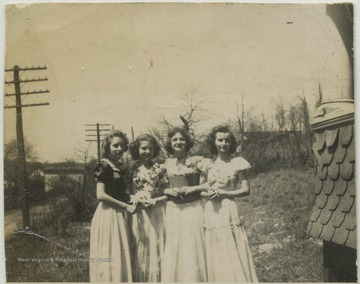 Four unidentified girls pose together for a group photo.