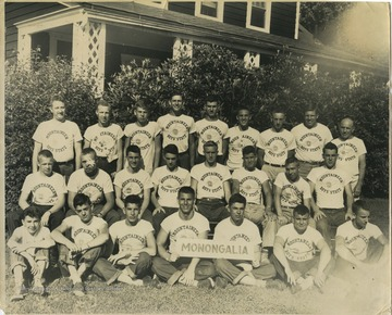 "Boys in the Mountaineer Boys' State program gather for a group photo, with members in the front holding a ""Monongalia"" sign. Subjects unidentified."