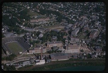 View overlooking Mountaineer Field and Woodburn Hall. Other university buildings seen are Chitwood Hall, Martin Hall, Woman's Hall (now Stalnaker Hall), Terrace Hall (now Dadisman Hall) the Armory Building, Mechanical Hall II, Brooks Hall, Arnold Hall, Armstrong Hall, Oglebay Hall, Clark Hall, Colson Hall, Elizabeth Moore Hall, Stansbury Hall, and the Downtown Library.