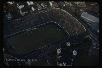 Aerial photograph of a West Virginia University football game against the Virginia Tech football team. The Mountaineers won this game 27-7.