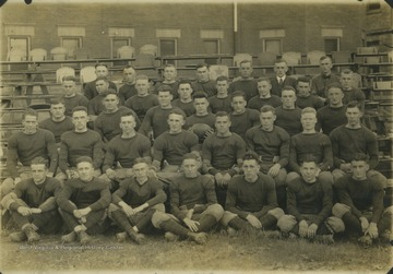 The football players pose together for a team photo.In the back row, from left to right, is unidentified; unidentified Coach Tobin; unidentified;  Coach McIntyre; Manager Sherr; and unidentified.In the fourth row, from left to right is unidentified; player Brooks, Fred Mills ('20); unidentified; unidentified; unidentified; quarterback Charles L. Lewis ('20); and pplayer Webster.In the third row, from left to right, is unidentified; tackle Joseph V. Harrick ('21); guard John B. McCue ('21); Captain Russell Bailey holding the ball('19); player Harris; unidentified; and halfback Andrew 'Rip King.In the second row is guard Russel D. Meredith ('21); player Curry; unidentified; tackle Frank Ice ('18); unidentified; unidentified; player Wagner; unidentified.In the front row from left to right is player Rhodes; halfback J. Howard Lentz ('20); unidentified; unidentified; unidentified; unidentified; unidentified.