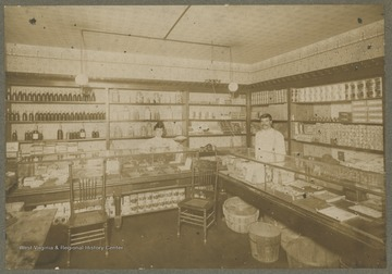 Interior of a general store, most likely in Morgantown, W. Va.  Items on the shelves include oatmeal crackers, candy, tobacco, and a variety of other canned, boxed, and bagged items.