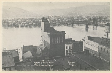 Photo postcard of Bridgeport, Ohio, and Wheeling Island during a flood. Postcard is part of a souvenir book of 1913 flood images.