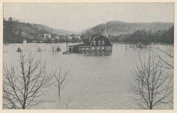 Photo postcard of an unidentified house surrounded by floodwater in Wheeling, W. Va. Postcard is part of a souvenir book of 1913 flood images.