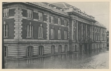 Photo postcard of a Baltimore and Ohio building during a 1913 flood in Wheeling, W. Va. Postcard is part of a souvenir book of 1913 flood images.
