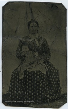 Mrs. Samuel F. Harsh (b. 1839-d. 1922) is pictured holding an unidentified child.