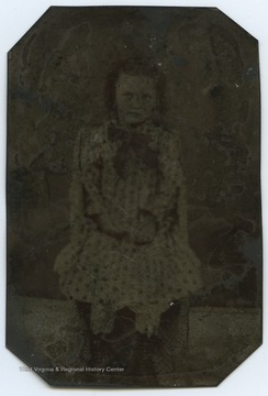 Kidwell (b.1876-d.1946) is about 6 years old in the photograph.