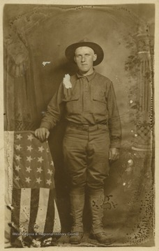 Zinn is pictured a soldier's uniform beside an American flag. Zinn is from North Central West Virginia, which includes Monongalia, Taylor and Barbour counties.