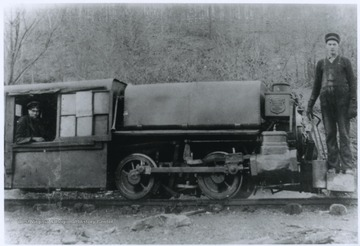 Engineer C. V. Berry, left, and brakeman Walter Bennett, right, are pictured with the coal company's railway engine.