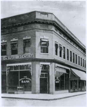 Photograph taken in the early 1900's shows the entrance to the Beckley National Bank, as well as Dr. Sutphin's dentistry.