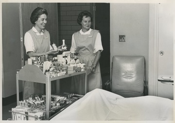 Two women offer snacks and other items to patients at the WVU Hospital. Friends of University Hospital is a non-profit organization that promotes the health and welfare of individuals in the Morgantown community.