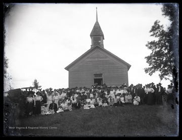 Members of the church and clergy pose outside of the church building which is located in Preston County, W. Va.