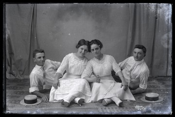 Two men and two women pose for a portrait.