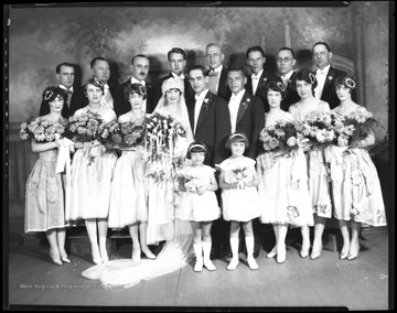 The Silling-Ziler wedding party gathers for a group portrait in the Gravely and Moore Photography Studio.