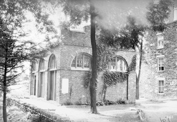 Photograph of the fort's exterior. It was built in 1848 as a guard and fire engine house for the federal Harpers Ferry Armory in Harpers Ferry, West Virginia, then a part of Virginia. Storer College was a historically black college. The fort was on the campus of Storer College from 1909 to 1968.