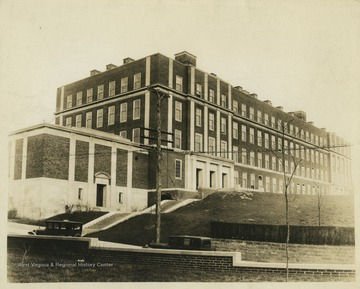 Clark Hall was the Chemistry Building located on the corner of University Ave. and Prospect St. To the right of the building and out of view is now the location of the Downtown Campus Library.