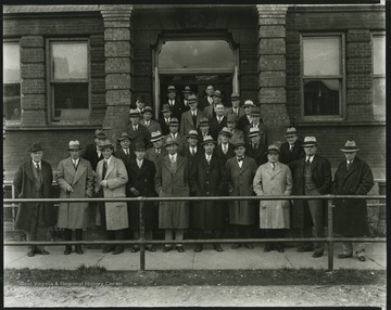 R. P. Davis's engineering class poses outside of the university building.
