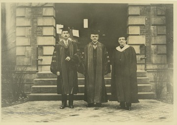 Turner, center, is pictured with two unidentified associates outside of a WVU building the day of his inauguration.
