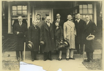 John Roscoe Turner, center, stands with unidentified associates outside of the old music building on this day of his inauguration.