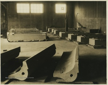 Molded cement structures fill a warehouse.