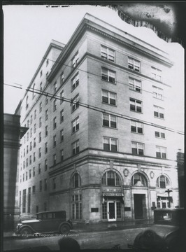 "The hotel is located on the corner of High and Moreland Streets.  A curtain in the left window advertises ""Frocks & Hats."""