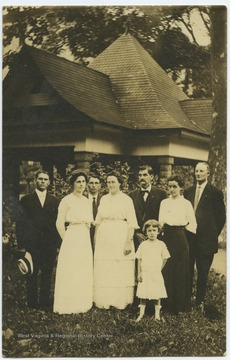 Third from right is W.T.W. Dye, M. D. To his front right is Sophia A. Dye. Other subjects unidentified.