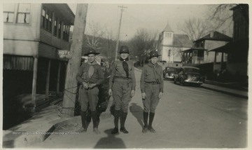 David B. Hathaway, center, poses with fellow Boy Scouts. On the left is the Jeffrey Hotel.