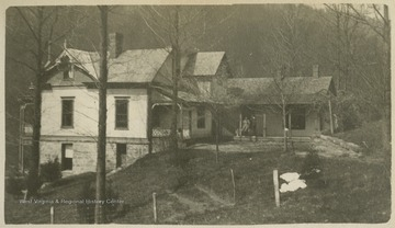 """The best view of ""Holly Hall,"" showing the back pourch [sic] where we all congregate in the evenings after supper to smoke, sing, and talk.""This photograph is found in a scrapbook documenting the survey for the Baltimore and Ohio Railroad in West Virginia and surrounding states."