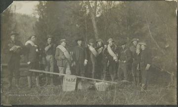 "A group of men pose with supplies before their journey to Camp ""High Life,"" where they slept in the open for several nights.This photograph is found in a scrapbook documenting the survey for the B. & O. Railroad in West Virginia and surrounding states."