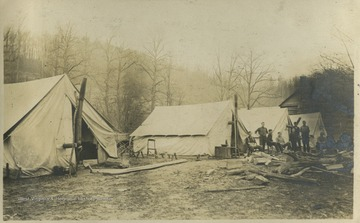 "The tents are identified as ""the Boers Nest"" (left), ""the Queen's Tent"" (center), and ""the office tent"" (right).This photograph is found in a scrapbook documenting the survey for the Baltimore and Ohio Railroad in West Virginia and surrounding states."