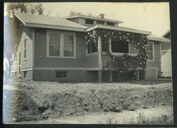 "Outside of house No. 29 in Nitro, W. Va.This was one of the 1,724 ""pre-cut"" houses Minter Homes Corporation built in Nitro.The design of the layout was named the ""Five-Room Executives Residence."""