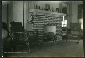 "Inside detail of house No.29 in Nitro, W. Va. Room shown in picture was part of the living-room.This was one of the 1,724 ""pre-cut"" houses Minter Homes Corporation built in Nitro.The design of the layout was named the ""Five-Room Executives Residence"""