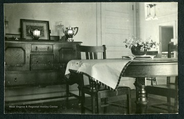 "Inside Nitro house No. 29, Nitro, W. Va. Room featured in picture is the dining roomThis was one of the 1,724 ""pre-cut"" houses Minter Homes Corporation built in Nitro.The design of the layout was named the ""Five-Room Executives Residence"""