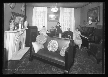 Four family members pose in their sitting room in Franklin W. Va.