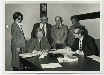 Standing left to right:Martha Trocin, William L. Young, Charles. Edward. Campbell Beall, Victorine Louistall-MonroeSeated left to right:Frederic Jay. Glazer and John Davison (Jay) Rockefeller, IVTrocin, Young, Beall, and Louistall-Monroe were all members (Commissioners) of the West Virginia Library Commission.