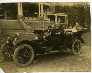 Seymour Harper family in car, parked in front of the Independent Order of Odd Fellows home in Elkins, W. Va.