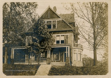 Photo postcard of the Delta Tau Delta fraternity house on North High Street in Morgantown, W. Va.