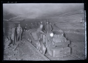 Men with loaded coal cars being hauled out of mine