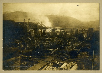 A view of the smoldering ruins of the Morgantown and Kingwood Railroad repair shops in Sabraton.