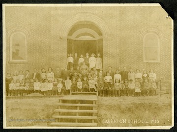 The students and staff of the Sabraton School gather in front of the school building for a group portrait.