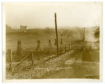 "An early view of the site of the Morgantown Municipal Airport during construction. Text on back reads, ""Municipal Airport: Road location from U. S. 119 - along second fence line."""