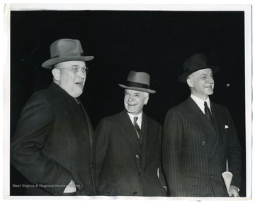 Assistant Secretary of War Louis Johnson, Secretary of State Cordell Hull, and Undersecretary of State Sumner Welles (left to right) wait at a Washington D. C. station for President Roosevelt to discuss the Nazi invasion of Denmark and Norway.