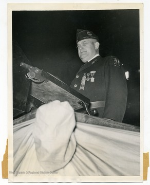 "Text on the back reads, ""The above photo shows Commander Louis Johnson of the American Legion as he addressed the members of the organization at the Chicago Stadium, Chicago, Illinois, when the convention was opened on October 2nd."""