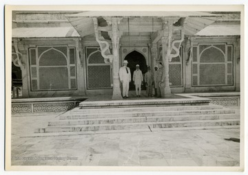 Colonel Louis Johnson and Colonel Griffith with Indians at the tomb of Sheik Salim Chisti at Fatehpur Sikri, India.
