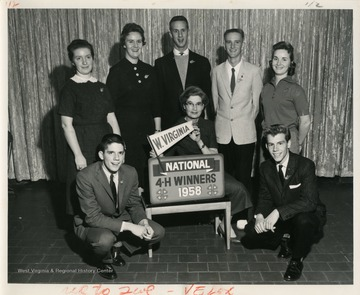 Front left to right: Guy Farmer of Lincoln County, Electric winner; Miss Margaret Adele Bigelow of Wood County, Alumni recognition; Kenneth Kissel of Marshall County, forestry winner.Standing left to right: Aleta Rae Strader ofUpshur County, Canning winner; Sally Ann Ours of Grant County, Achievement winner; Ralph Izard of Boone County, recreation winner; Dwaine Hornbeck of Upshur County, beautification of home grounds winner, and Joan Lee of Kanawha County, leadership winner.