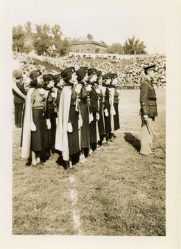 Female ROTC group gathered on football field.