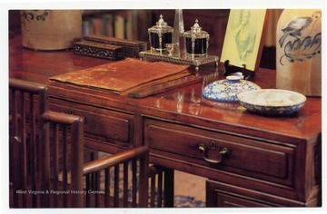 """The ""Good Earth"" desk- an antique Chinese hardwood piece at which Nobel Prize and Pulitzer Prize winning author Pearl S. Buck penned her famous novel- is on display with other Asian and American antiques."""
